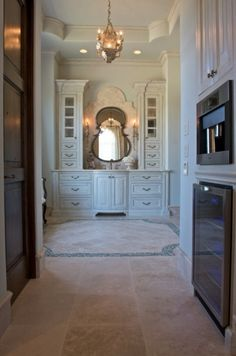 A gorgeous master bathroom with coffee and fridge area.