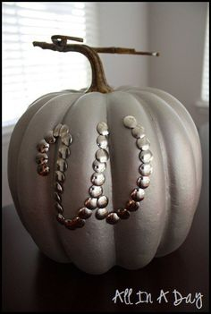 Metallic spray paint over pumpkin with thumb tack monogram... Gorgeous!