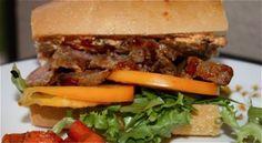 Бутерброды со шпротами и помидором и сыром