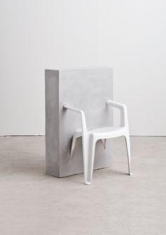Concrete, plastic chair.