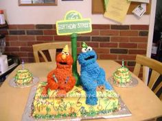 Homemade Elmo & Cookie Monster Cake: This Homemade Elmo & Cookie Monster Cake was, hands down the most awesome cake I've ever done. I sculpted the heads out of rice crispy treats and the bodies