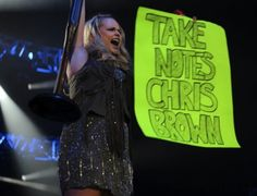 Miranda Lambert held up this sign before singing a song about a woman shooting her abusive spouse. Girl power, bitch. She is seriously the best.