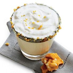 Peanut Brittle Milk Punch | We take the flavors of a favorite Southern candy and whip them up to create a frothy punch. | SouthernLiving.com