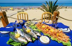 Bass and shellfish in Costa da Caparica. Portugal
