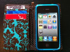 This soft iPhone wallet comes with a gel case for your phone that attaches inside the wallet with velcro. It closes with an elastic band. A wrist loop is also available.