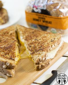 Garlic Butter Grilled Cheese - the ultimate grilled cheese sandwich made with 3 types of cheese, Dave's killer bread, and spread with homemade garlic butter.