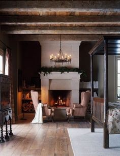 A cozy fireplace, ceiling beams, floors