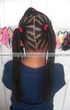3 cornrowed  ponytails (back)