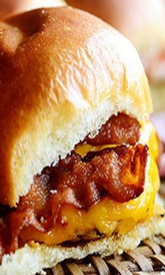 Grilled Chicken Bacon Sliders...with pepper jack cheese and served on dinner rolls. These little sandwiches are sure to please all your family and friends at your next party! Recipe from the Pioneer Woman.