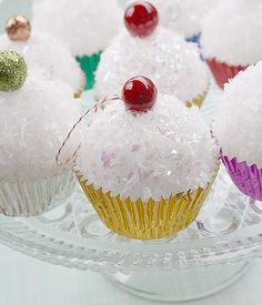 It looks to me like you put a styrofoam ball that fits in a cupcake liner and then cover with sparkly tri-pointed beads.