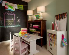 This kids craft room features a full wall chalkboard wall and a craft table and chairs from @Matty Chuah Land of Nod - so fun!
