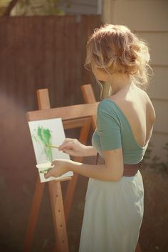 Hey painting in that dress with hair up lady