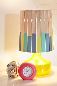 Glue paint-coated stirrers to an inexpensive drum shade (10 Uses for Paint Stirrers)