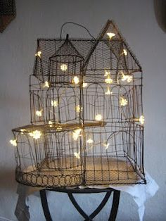 Light wire birdcages or glass terrarium houses with solar string lights if you want to place them in the garden...
