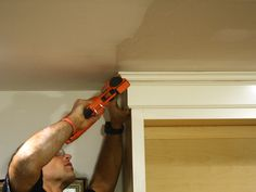 DIY:  How to add crown molding to cabinetry.  Wow, this is an awesome tutorial!  It uses inexpensive 1x4's & 2x4's as a base, then mouldings are attached to the base.