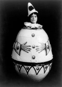 Photo of woman in wooded egg costume as human roly poly dancing dolly in 1915.