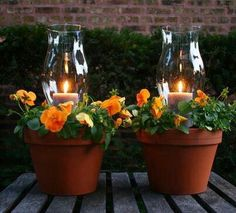 Great outdoor party table centerpiece, maybe with white flowers and burlap around the pots