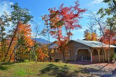 Bear Hugs cabin rental near Pigeon Forge, TN. This 1 level cabin will wow you with it's one of a kind views of The Great Smoky Mountains.  Perfect for a couple or small family.  This cabin has a king size bed, BBQ grill,  pool table, washer/dryer, and fireplace.  A hand carved door with a bear and open floor plan are just some of the many perks of this beautiful cabin. A jacuzzi tub on the deck can make any getaway romantic!