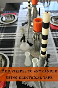 Electrical tape on white candles for Halloween