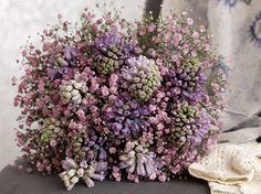 Two blue toned hyacinths, combined with pale pink gypsophilia