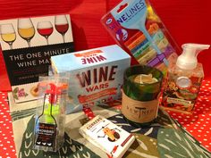 """Host/hostess gifts for this weekends """"dinner"""" party...let's just be honest...it's a wine party!!! * Wine Wars Trivia Game, Wine Lines wine markers from Fred, Showbird silicone bottle stopper set from Make My Day, Rewined Merlot soy wax candle, Flora Exotica Shea Butter hand soap from Michel Design Works, Danica Flora & Fauna tea towels, The One Minute Wine Master book by Jennifer Simonetti-Bryan, MW."""