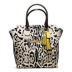 Fashion is all about contrasts. For the Holidays try to play with contrasts as well. For example: try to mix an animal print + a bold color. Coach - Legacy Ocelot Haircalf Tanner Tote.