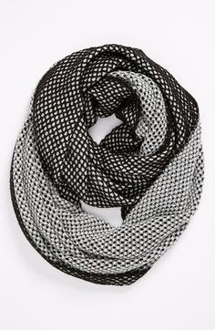 Staying warm in this reversible infinity scarf. | $42.00