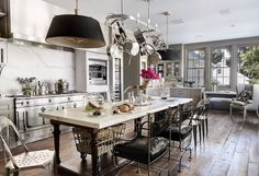 Veranda: Windsor Smith Home - Stunning kitchen with gray moulding, rustic wide wood plank wood.