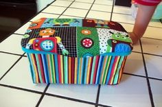 Cover a wipes box with fabric! Glue gun and scraps.