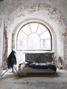 Bedroom interior with exposed brick window | Murray Mitchell