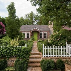 Adorable little cottage house (especially love the green door)!