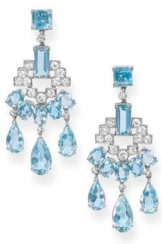 A PAIR OF ART DECO AQUAMARINE AND DIAMOND EAR PENDANTS, BY CARTIER.   Each designed as an openwork diamond panel to the five oval-shaped aquamarines suspending three drops, circa 1930.