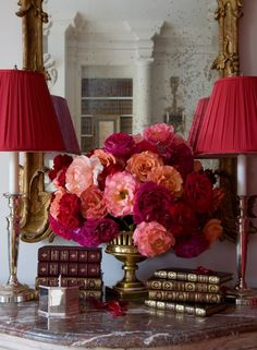 red lamps, blooms and books