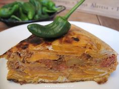 The Spanish version of sweet potato pie, or the Southern version of the typical tortilla española. Either way, a delicious combination of spicy and sweet that is great for a potluck or as a Plan B for dinner.      Spanish Tortilla with Yams & Chorizo   Gambas and Grits: A Texas Foodie Deep in the Heart of Spain