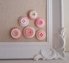 Button Magnets.  Go through your button stash and glue layers together and add a magnet.  Make a magnetic board using a picture frame.  Very cute!!