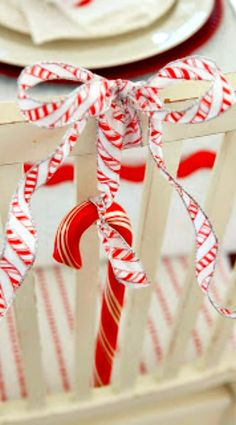 A large candy cane with a large bow... always is a nice touch on the back of your dining room chairs