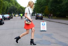via Vogue    #orange #skirt #black #booties #model #fashion #street #style