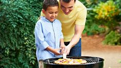 Grilling time! Like father, like son.