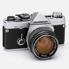 Analog Olympus OM-2 camera.