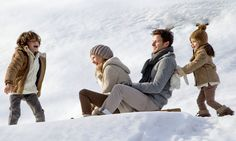 Sharing a sledge on a winter family luxury holiday