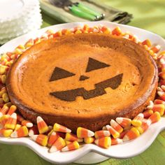 1 #Crust      1 ½ cups Graham Cracker Crumbs     5 tbsps. melted butter     1 tbsp. sugar  Filling      1 cup Sugar     3 (8 oz.) packages of cream cheese     1 tsp. vanilla     1 cup canned/purée pumpkin     3 eggs     ¼ tsp. nutmeg     ¼ tsp. allspiceTopping      Chocolate powder