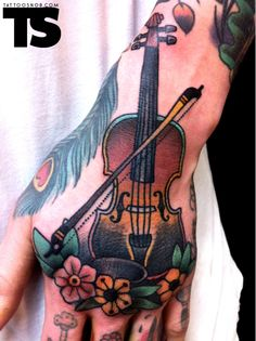 Violin/ Viola hand tattoo (it even has a peacock feather!)