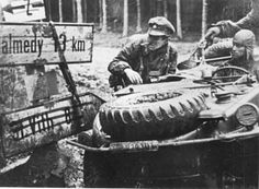 The early hours of the Battle of the Bulge: Waffen SS troops in a Schwimmwagen at the Kaiserbaracke crossroads in the Ardennes, December 1944.
