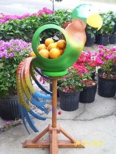 recycled tires ideas | Do you need an idea on how to recycle tires? Tires as flower pots is ...