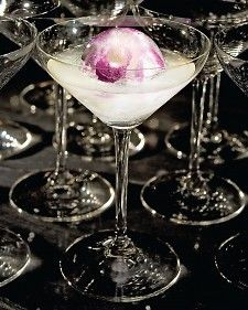 """There's no fear of staining your cocktail dress with this cosmo -- it's made using white cranberry juice. The recipe is from """"Cocktails and Amuse Bouches,"""" by chef Daniel Boulud and mixologist Xavier Herit."""
