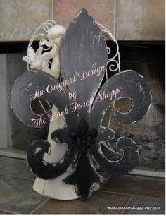 I need this fleur de lis for my shabby chic black, white & green living room. $75