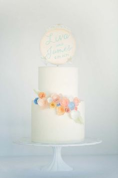 Beautiful whimsical wedding cake by Hey there, cupcake!   Love the watercolor cake topper DIY