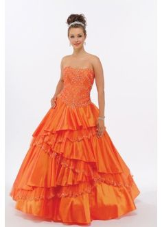 Cascading Orange Quinceañera Dress Sweet Sixteen Dress. Strapless gown with a curved neckline and lace covered corset bodice. Asymmetrical layers of tulle and taffeta fall down the full skirt.