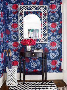 Designer Ashley Whittaker chose Osborne & Little's Maharani wallpaper for the entry in a small Manhattan apartment.