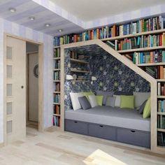 Comfy in-shelf seating. #Libraries #Bookshelves #Books #LivingRooms #Sofas #Storage #Grey #White #Green #Wood